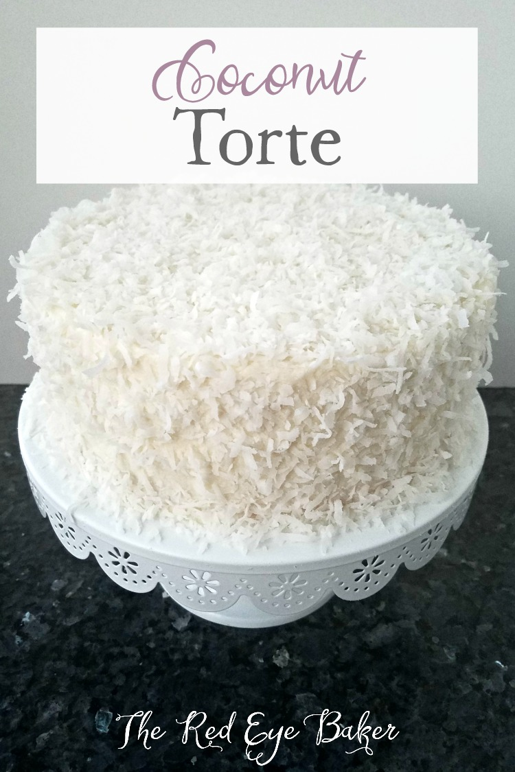 Coconut Torte | Bring a little taste of sunshine to your kitchen with this Coconut Torte! The coconut and simple raspberry filling will have you looking forward to sunny summer days in no time!